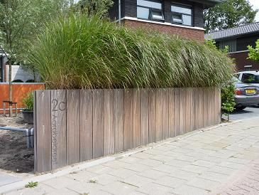 Adres op houten schutting Adres fence.