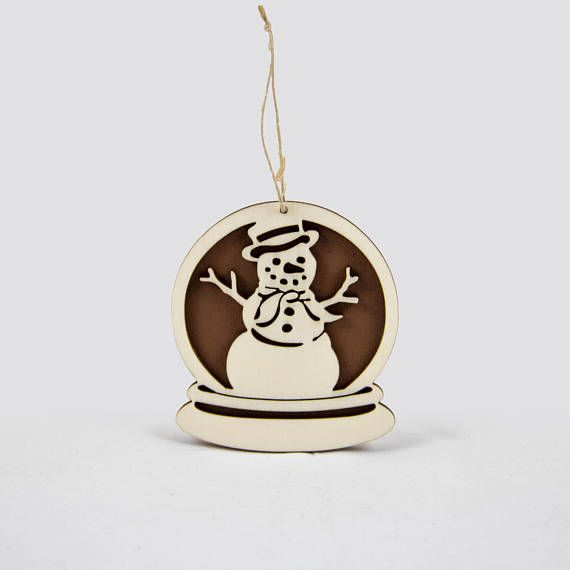 Wooden snow globe Christmas ornament with a snowman.