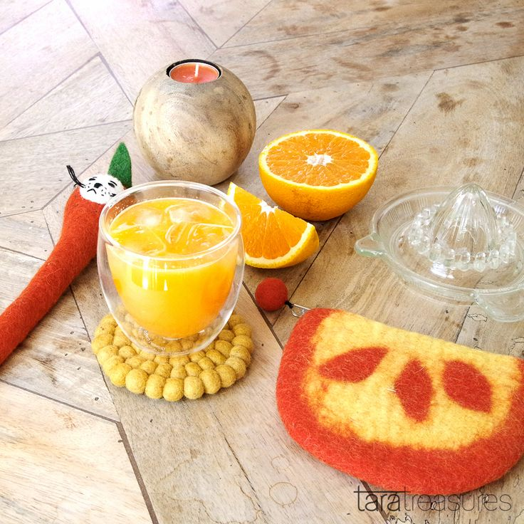 Beat the heat as Melbourne sizzles. Juiced up on cold-pressed oranges. Pictured here with orange peel coin purse and pencil cover from Tara Treasures market stall. #flatlay #orange