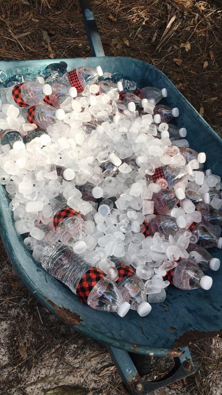 Lumberjack party DIY bottles in old wheelbarrow