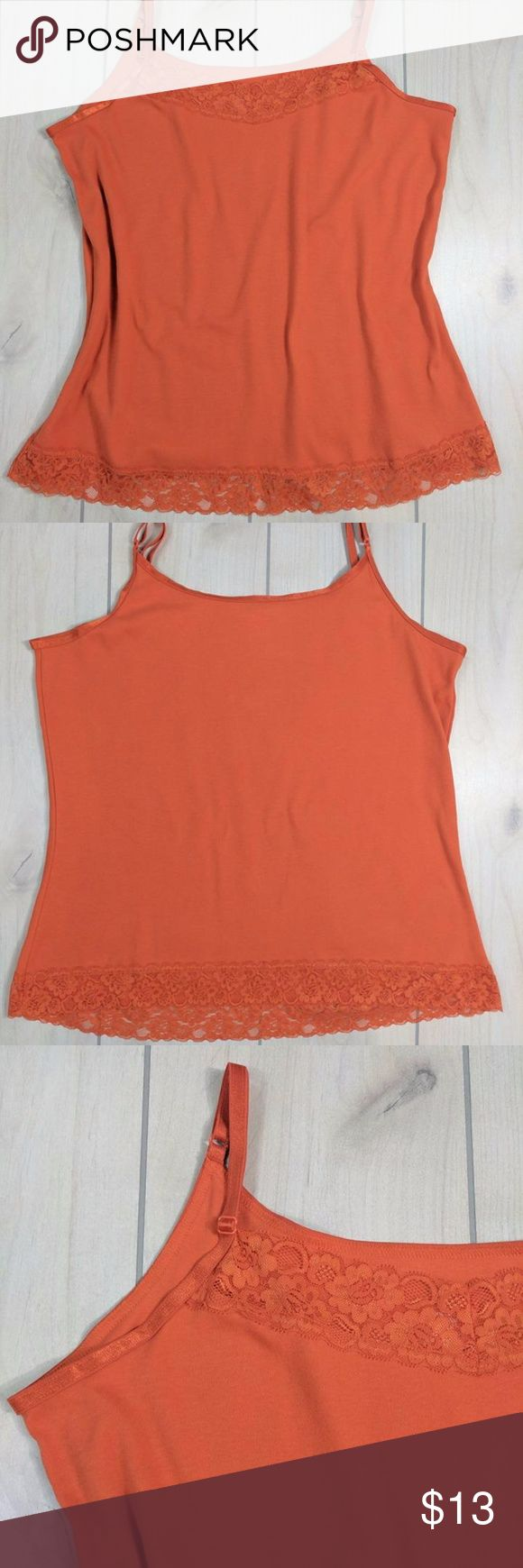 """CJ Banks Orange Cami Adjustable Straps Stretch 1X Adorable orange lace trim cami. This top is orange. Some of the pics look a little washed out but the top is a beautiful orange.  98% cotton. 2% spandex stretch. Adjustable straps.  Chest around at underarms measures 45"""" Length from top of shoulder with strap at longest point 30"""". Waist 44"""" around. Bottom hem 48"""" around. Excellent condition. Smoke free. BLT3 CJ Banks Tops Camisoles"""