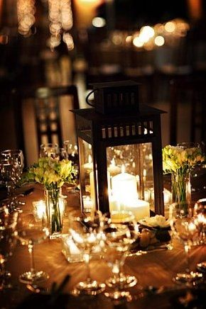 lantern with small bouquets and candles for other tables