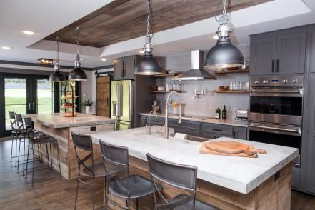 Standout features in the new kitchen include the large twin islands with concrete countertops, a custom box ceiling with reclaimed wood-panel inset and industrial styled pendants providing generous task lighting above the islands.