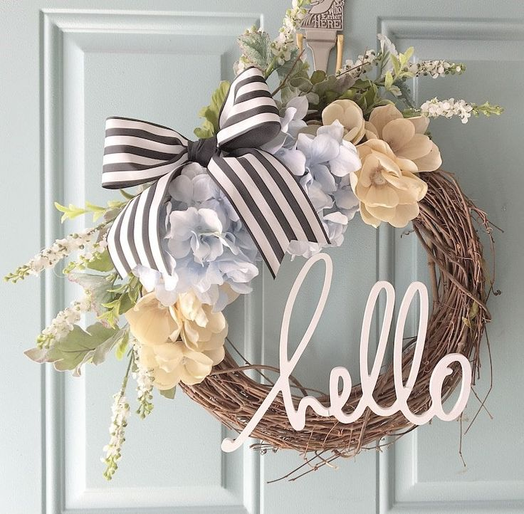 This gorgeous wreath is a MUST HAVE for the upcoming spring season! (Or ANY season!)  It will look perfect hanging on your front door or displayed inside on a mantle or shelf!  Welcome guests with a cute little message that compliments the wreath perfectly!  DETAILS - 12 grapevine wreath - Spring/southern themed flower stems - Wooden hello word  *Please note: Due to availability, some flowers/colors may vary from the photos shown. Not to worry! I will work with you to create your pe...