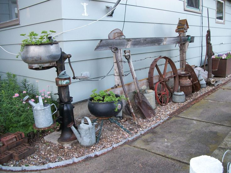 https://flic.kr/p/VSUKsf | Who Does This? | Piles old junk by the house!  Well, to me it is a bit of country history, from the hand pump for the well to the hand cranked cream separator and all the tools in between. It can bring back memories for a lot of people, some not so pleasant when you think of all the work they did.