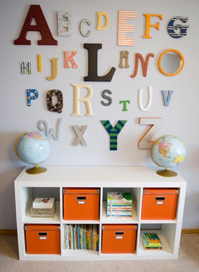 Alphabet Wall and Small Expedit Ikea shelf. Love the different sized and shapes of the letters and the simplicity of the shelf.
