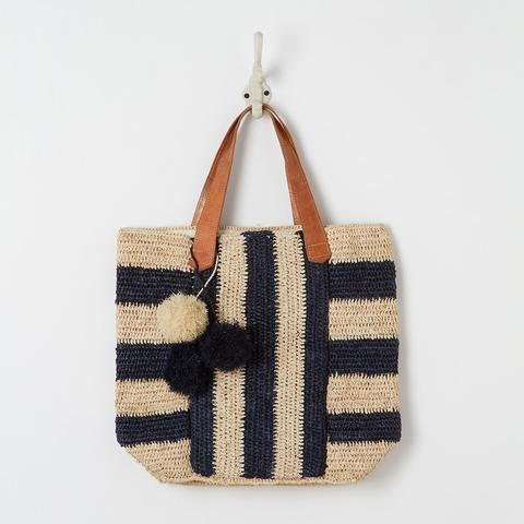 crocheted tote with pom-poms