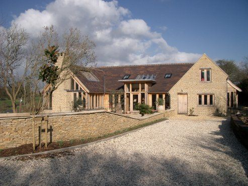 Approach to new Cotswold barn house by Roderick James Architects