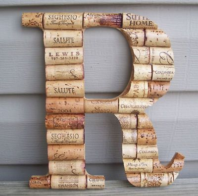 Homemade cork Monogram sign...so doing this when we move..if i did it now it would come up missing!