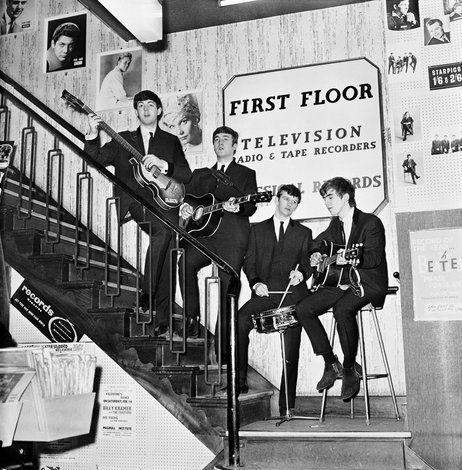 The Beatles on the stairs of NEMS — North End Music Stores,  Brian Epstein's Liverpool record shop — having just signed a management deal, in 1964.