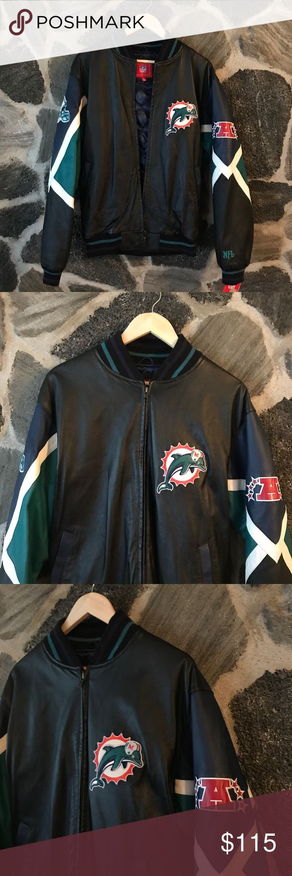 Vintage• NWT official NFL Dolphins leather coat ** BRAND NEW WITH TAGS! 🎅🏼🎄 PERFECT CHRISTMAS GIFT FOR ANY MIAMI DOLPHIN FAN **  Size: medium (runs bigger) Condition: BRAND NEW WITH TAGS OFFICIAL NFL BRAND; Genuine leather Very warm, comfortable, classic. Retail: $179  #gift #present #christmas #cybermonday #nfl #football #miami #dolphins #fins #leather #coat #authentic Jackets & Coats Bomber & Varsity
