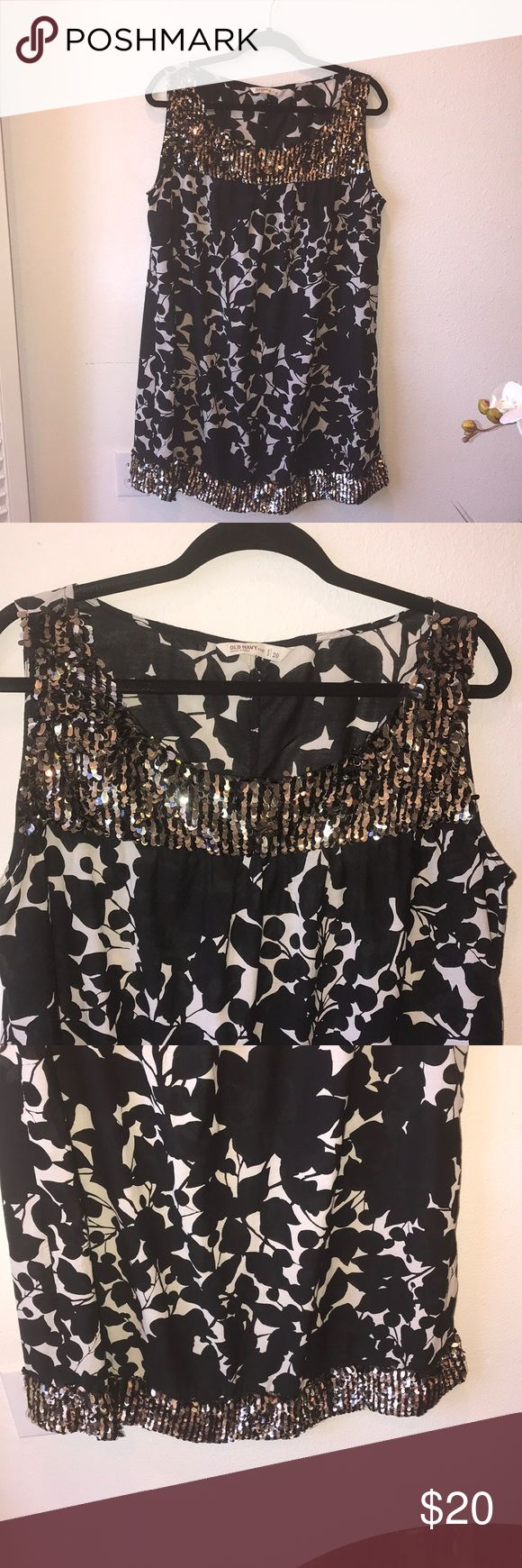 "Sparkly Tunic Dress EUC, old Navy black and white tunic dress. Sparkly gold, silver, and black sequins at bib and bottom. Is missing a few sequins but you can't tell because it has so much bling! Very light cotton material. Measurements are shoulder to hem 36,"" bust is 23."" I ❤️ offers! Old Navy Dresses Midi"