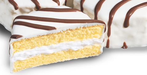 Little Debbie: Zebra Cakes. Would be cute on a tiered platter with various animal print wrapped cupcakes... Instead of a cake.