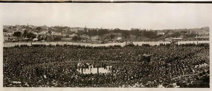 A mammoth crowd assembled at the Sydney Stadium, Rushcutters Bay, on 26 December 1908. This is the famous 'Boxing Day battle' between Tommy Burns and Jack Johnson for the world's heavyweight championship. African American Jack Johnson overcame the odds and defeated Burns after 14 rounds. Photograph by Charles Kerry. Mitchell Library, State Library of New South Wales: http://www.acmssearch.sl.nsw.gov.au/search/itemDetailPaged.cgi?itemID=442922