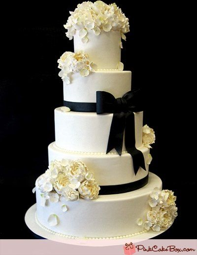 simple black and white wedding cake - ribbon/roses