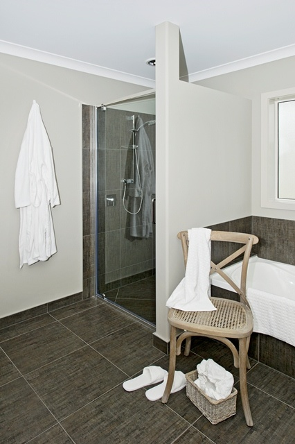 A clothes chair, essential in the livable bathroom.