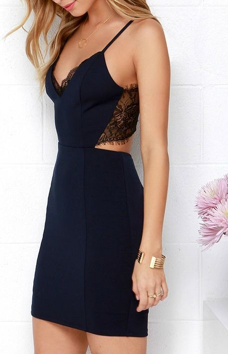 The lacy look of the Heartbeat Song Black and Navy Blue Backless Lace Dress is enough to make any girl's heart race with excitement! Deep navy blue stretch knit starts at the halter straps of the triangle bodice, finished with princess seams, and a black laced-trimmed neckline. #lovelulus