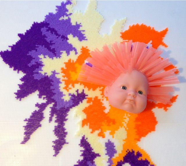 Sculptural Wall Piece: Trophy by the Danish Designer and Artist Louise Lagoni. Mini Hama pearls. Doll head with straw hair.