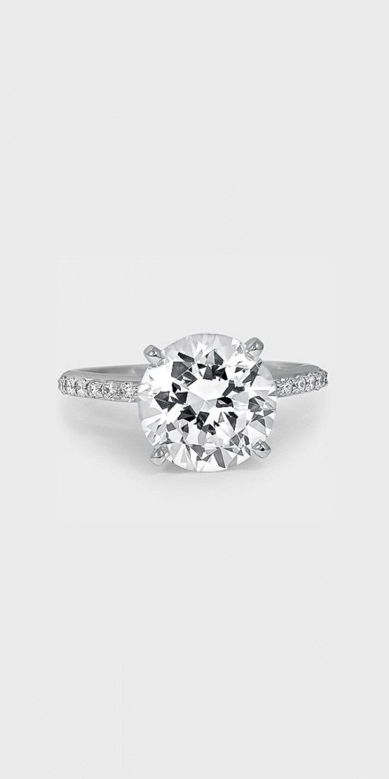 This delicate ring features sheer sparkle that extends halfway around the ring. The center diamond appears to float above the delicate band.