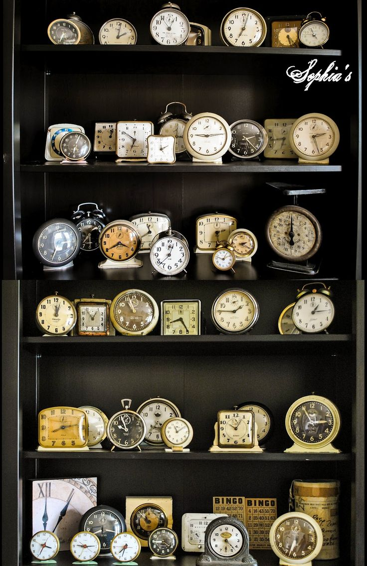 vintage clocks on shelves.. Wow! What a collection!