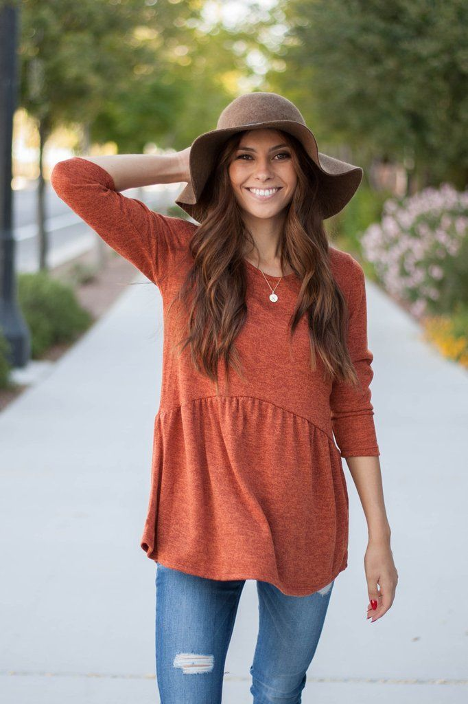THE TEXTURED PEPLUM IN RUST