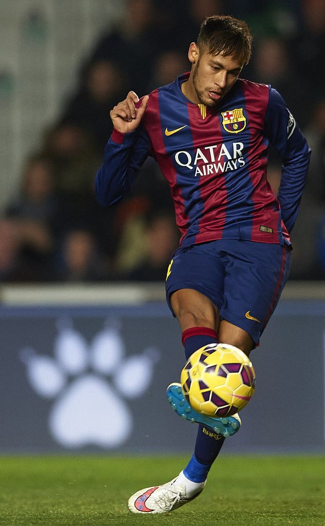 Neymar JR of Barcelona shoots for score the fourth goal during the La Liga match between Elche FC and FC Barcelona at Estadio Manuel Martinez Valero on January 24, 2015 in Elche, Spain.