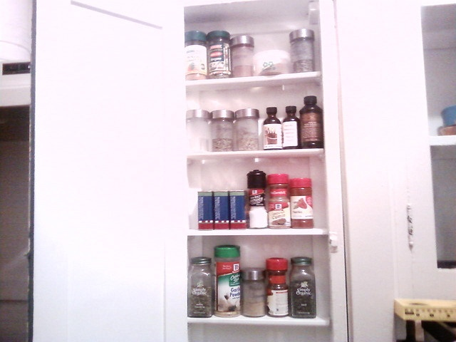 DIY project of the evening: ironing board cabinet to spice rack! by How I See Life, via Flickr
