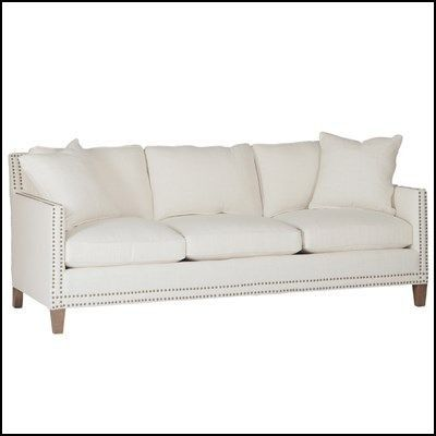 white leather sofa with nailheads