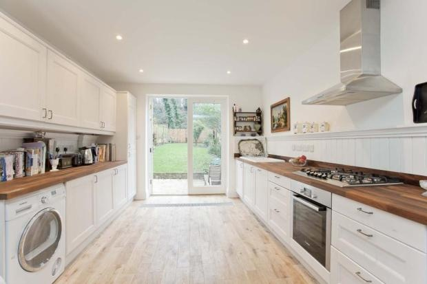 WHITE GALLY KITCHEN   LIGHT AND AIRY  FRENCH DOORS
