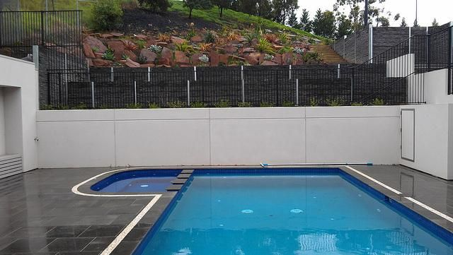 Pool surround Niddrie: In this case the Landscape Tanks were used as structural retaining walls and fantastic looking pool surrounds with great results. Lots of water storage as well. www.landscapetanks.com.au