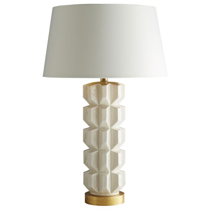 Contemporary structure gives the arteriors gilda table lamp a mod statuesque presence finish in glossy white cracked porcelain this light fixtures