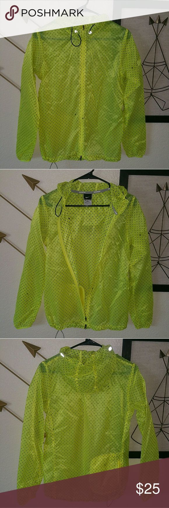 Nike Running Jacket This is a very light weight. It is rain proof. Has a hoodie. It's bright yellow with black polka dots. There is no front pockets. But one back poket. Has a string tightener at the bottom of the jacket. Nike Jackets & Coats