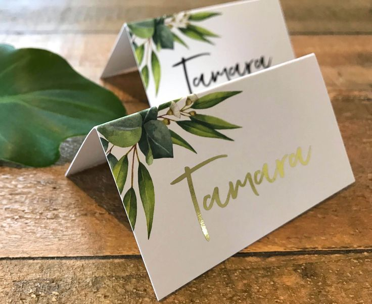 A gorgeous native greenery place card | tent card | escort card with native eucalyptus leaf graphics and a gorgeous script font with OPTIONAL foil added to your names. Place cards are completely customisable and can be used for any occasion.