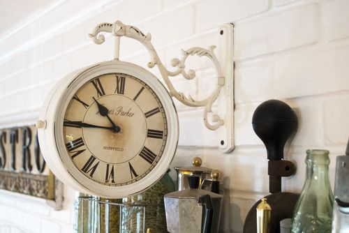 This double-sided clock from Hobby Lobby works perfectly with the antiques on display above the oven, including espresso pots from Italy and a childhood bicycle horn. With an endless supply of cash, anyone should be able to be surrounded by beauty, but it's the real magic happening when you can do it within a budget.