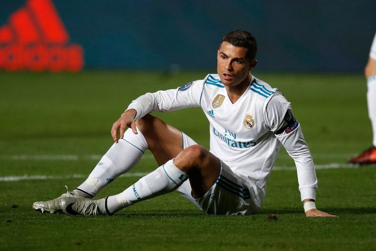 Cristiano Ronaldo Photos - Real Madrid's Portuguese forward Cristiano Ronaldo get to his feet during the UEFA Champions League Group H match between Apoel FC and Real Madrid on November 21, 2017, in the Cypriot capital Nicosia's GSP Stadium.  / AFP PHOTO / Thomas COEX - APOEL Nikosia v Real Madrid - UEFA Champions League