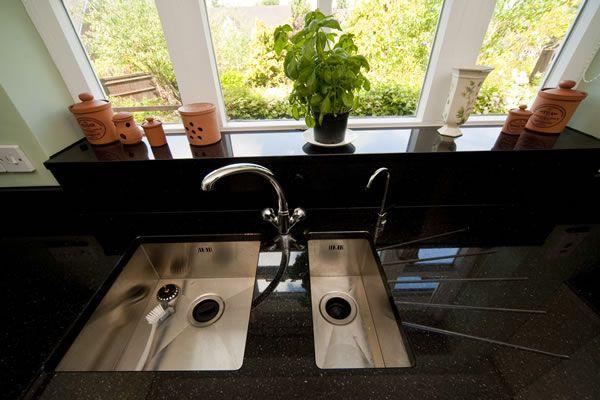 Black Galaxy Granite worktops, twin undermounted sinks, windowsill