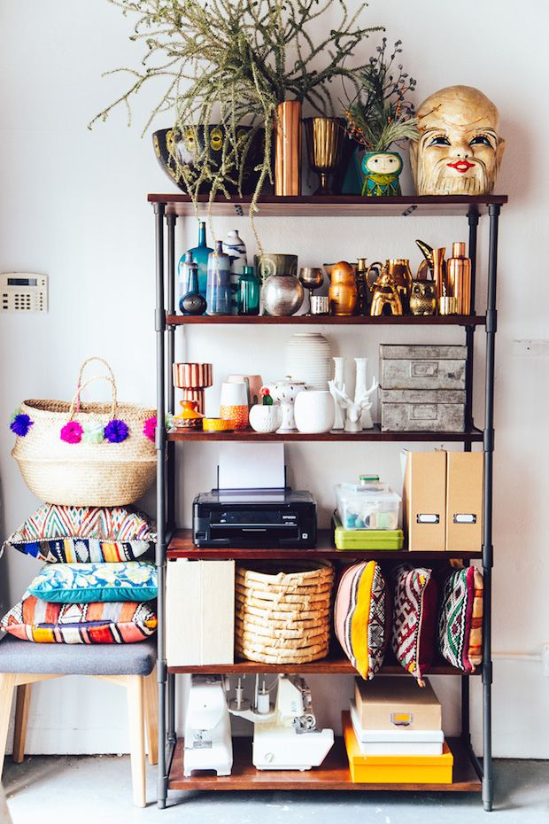 Relaxed open shelving in a happy and relaxed, boho studio in L.A. Justina Blakeney.