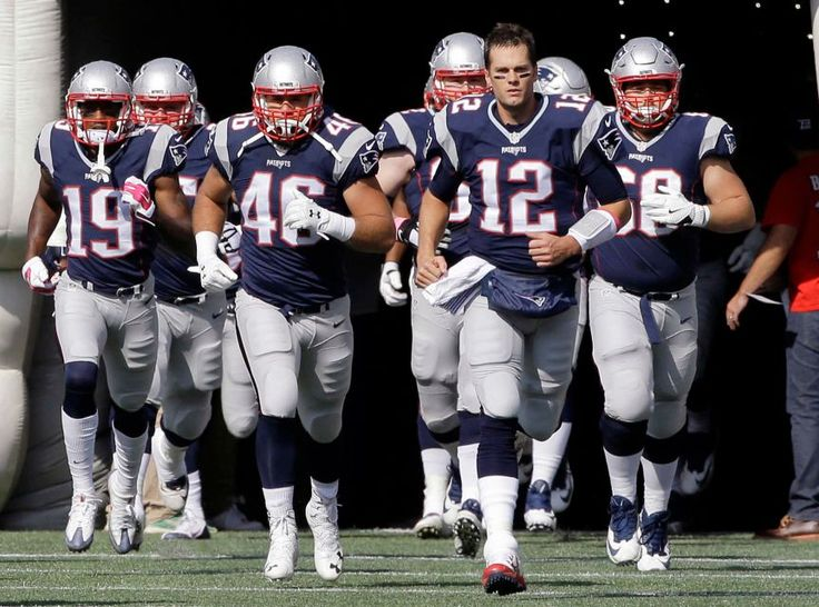 Bengals vs. Patriots:     October 16, 2016  -  35-17, Patriots  -    New England Patriots quarterback Tom Brady (12) leads the team onto the field for an NFL football game against the Cincinnati Bengals, Sunday, Oct. 16, 2016, in Foxborough, Mass.