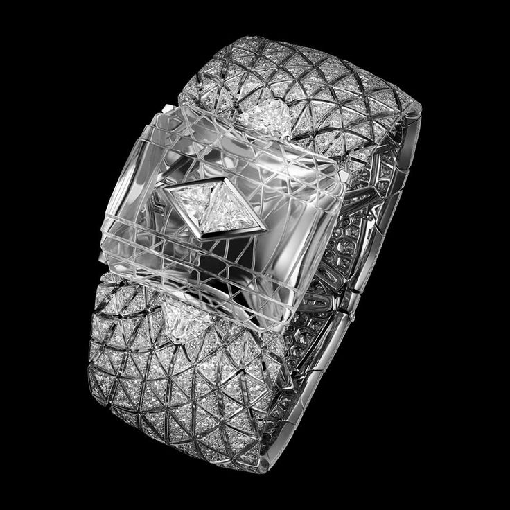 "CARTIER. ""Romanov"" Bracelet - Platinum, carved rock Crystal motif, one 1.03-carat F SI1 and one 1.02-carat E VS2 triangular-shaped Diamond, two D IF modified shield step-cut Diamonds totaling 2.50 carats and brilliant-cut Diamonds. The carved rock Crystal can be replaced by a Sapphire. Étourdissant Cartier 2015 High Jewellery"