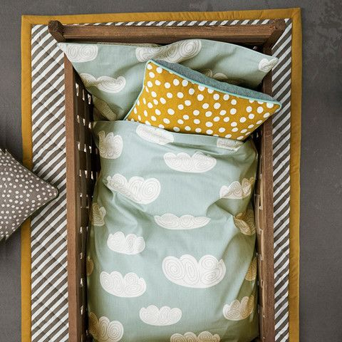 Minty blue and mustard colour pallet for baby's nursery