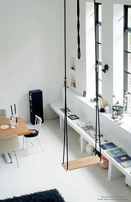 an indoor swing.  How fun.  It sure looks up high though