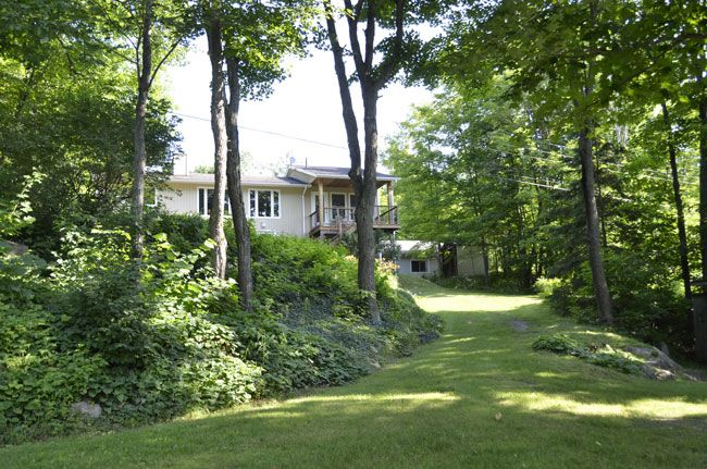 Parry Sound Area:  Year round waterfront home/cottage modern designed open concept kitchen has built in appliances, an patio overlooking lake. There is storage space, laundry room, rec room, central air, central vac and a wood stove in lower level.  A circular driveway, attached garage, a heated work shop and a wood shed. Along the shore there is a dock, a sauna and a sleeping cabin. Not sure what more you could need! #328.14A   ANOTHER SOLD!