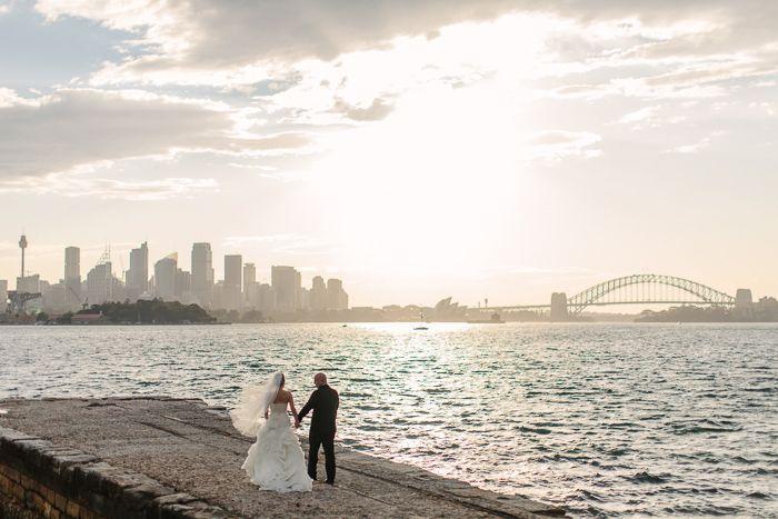 Beatufiul Sydney wedding photo featuring Harbour Bridge and the Sydney Skyline | Image: Jonathan David