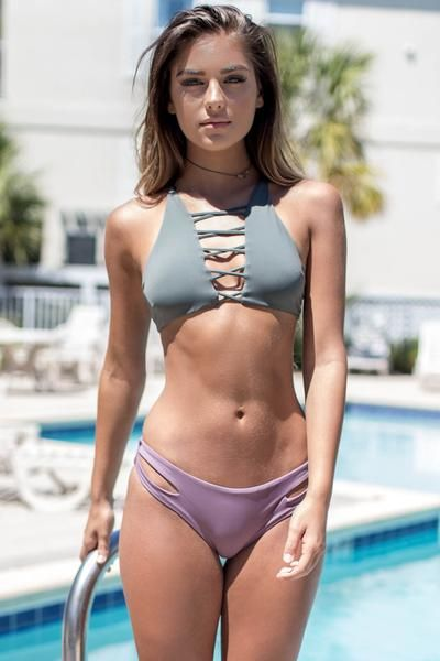 Black bikini bottoms are seamless and feature double strap sides with a cutout Material is Nylon