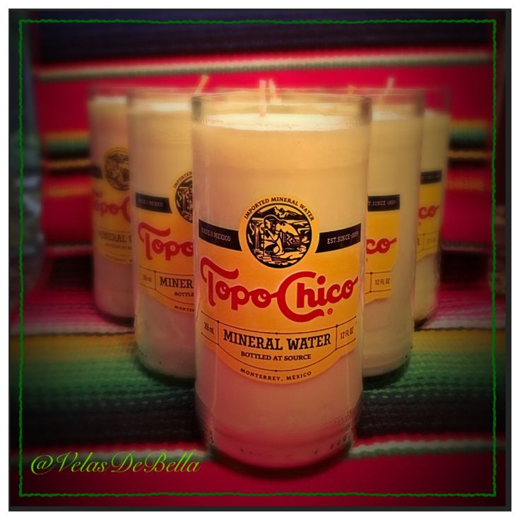 I've hand-cut and smoothed #iconic glass Topo Chico bottles then poured vanilla wax into them to make #candles!  Once completely burned, they make great bud #vases, pen/pencil holders, or makeup brush holders.  Click through to purchase on my #Etsy store.  #TopoChico #VelasDeBella #Vela #ReduceReuseRecycle #Recycle