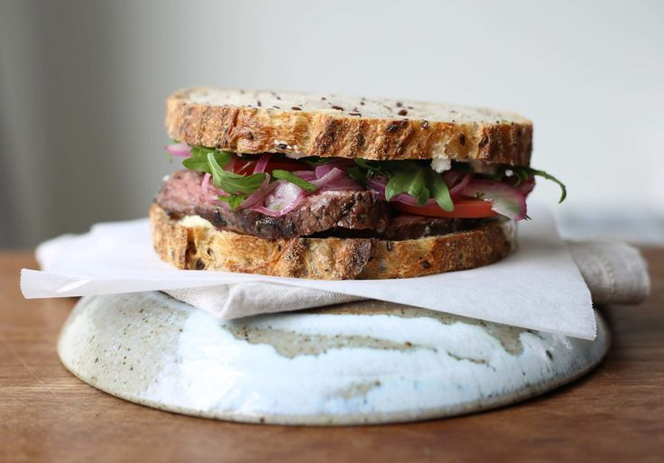 Hanger steak sandwich with marinated onions