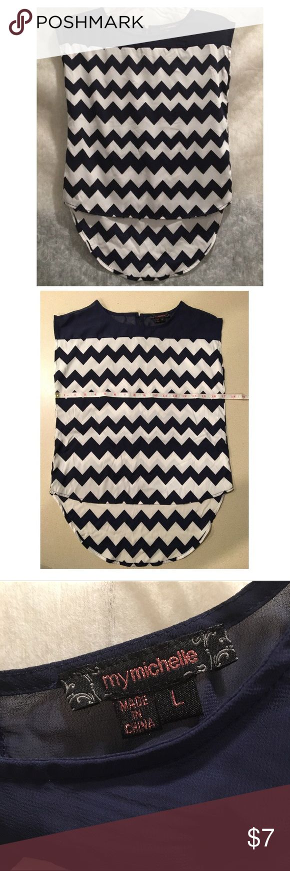 Cute chevron blouse navy and white Chevron blouse navy and white this blouse is L  but  runs small check measurements Never used My Michelle Tops Blouses