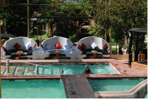 Cosala Grand San Juan Cosala, Jalisco Located just 100 metres from Lake Chapala in San Juan de Cosala, this hotel features several hot-spring pools, a hot tub and tropical gardens. Cosala Grand also has an on-site game room.