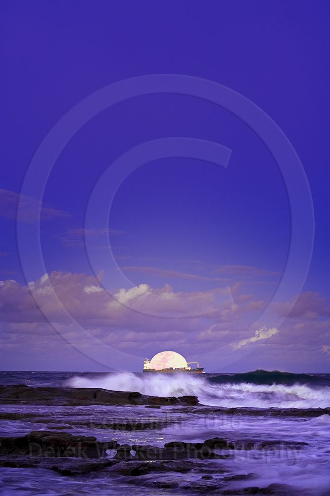 A cargo ship loaded with shipping containers sails past a rising full moon off the Coloundra Headlands on the Sunshine Coast, towards the port of Brisbane on Fisherman's Island in Queensland, Australia. For image licensing enquiries, please feel welcome to contact me at derekwalker73@bigpond.com  Cheers :)