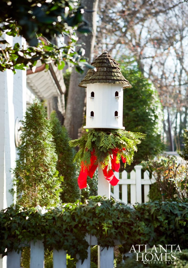 Festive white birdhouse, all decked out with a Christmas welcome for some sparrows wintering over...